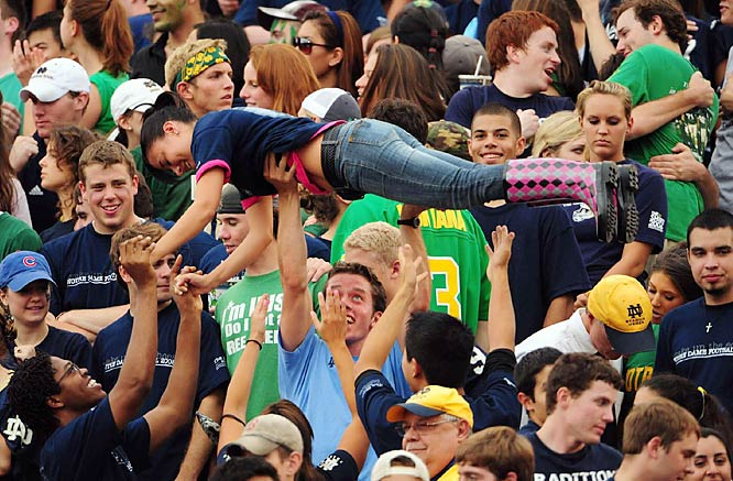 This Irish fan crowd-surfs across the Notre Dame student section to celebrate the Irish lead over Michigan.