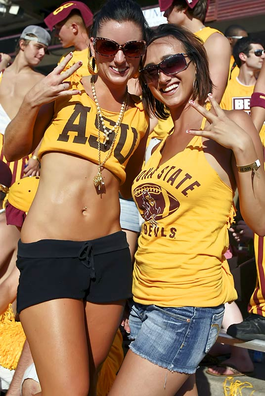 Two Arizona State fans flash Sparky's pitch-fork sign to show their Sun Devil pride.