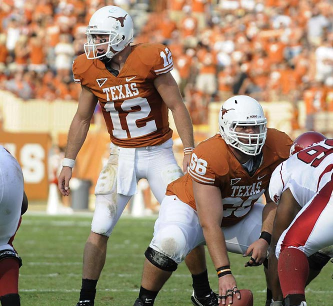 Led by Heisman candidate Colt McCoy (12), the 'Horns charged to a 42-point walloping of Arkansas.
