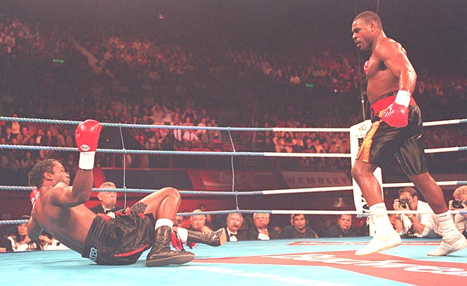 Oliver McCall TKOs Lennox Lewis in the second round to win the  heavyweight boxing title in  Lewis' home town of London, England.