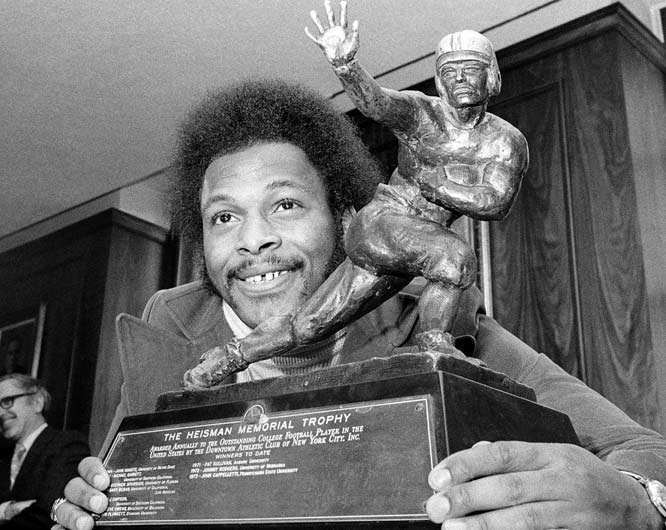 Ohio State's Archie Griffin gets his first of a record 31 consecutive 100-yard rushing games.