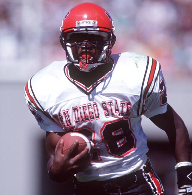 San Diego State freshman Marshall Faulk sets an NCAA rushing record with 386 yards.