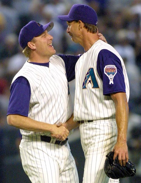 Diamondback righty Curt Schilling strikes out his 300th victim to join Randy Johnson in becoming the first teammates to each strike out at least 300 batters in the same season.