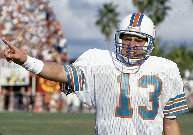 In Miami's 39-35 victory over New England, Dan Marino  becomes the second quarterback with 300 touchdown passes by throwing for five scores. The Dolphins' QB also establishes an NFL record with his 18th game of four-or-more touchdown passes.
