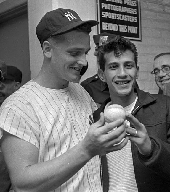 A panel of eight baseball experts vote to drop the asterisk next to Roger Maris home run record and determine an official no-hitter must go at least nine innings.