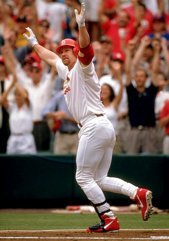 Mark McGwire connects off Cub hurler Steve Trachsel and sends a 341-foot line-drive over the left field fence for his historic 62nd home run, breaking the single-season home run record set in 1961 by Roger Maris.