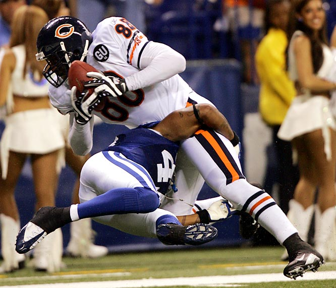 Tight end Desmond Clark is tackled by Colts safety Antoine Bethea on the one after picking up 26 yards in the fourth quarter of the Bears' 29-13 victory.