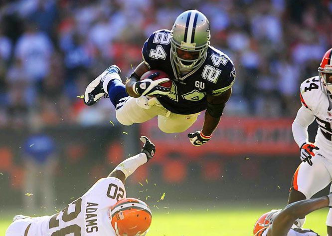 Marion Barber dives over Browns safety Mike Adams for extra yardage in the second quarter of the Cowboys' 28-10 win.  Barber had 16 carries for 80 yards and two touchdowns.
