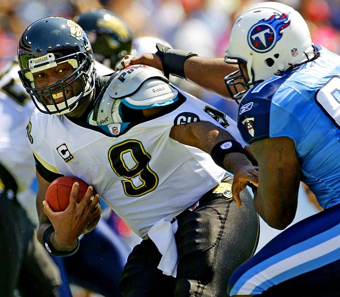 David Garrard tries to get away from the grasp of Titans defensive tackle Tony Brown during the Jaguars' 17-10 loss.  Brown had two of Tennessee's seven sacks in the game.