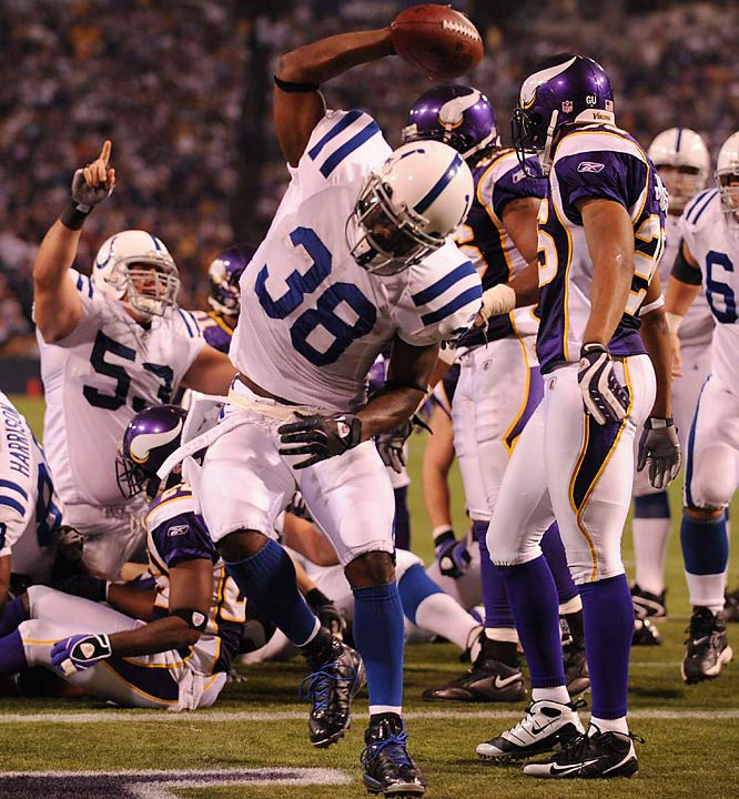 Colts' running back Dominic Rhodes spikes the ball after scoring on a two-point conversion that tied the game against the Vikings in the fourth quarter. Indianapolis won 18-15 after kicking a field goal with three seconds left.