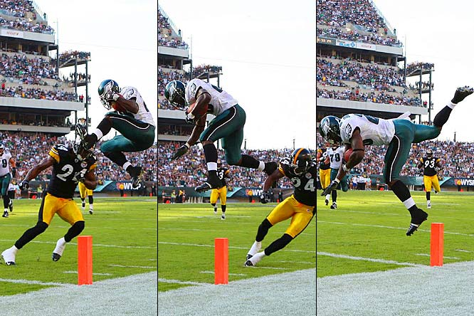 Correll Buckhalter leaps over cornerback Ike Taylor to score the game's only touchdown during the second quarter of the Eagles 15-6 victory over the Steelers.