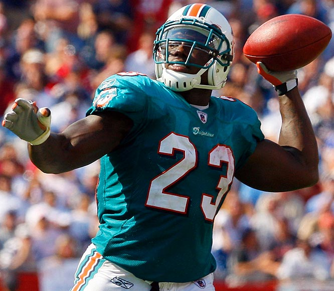 Ronnie Brown scored a team-record four touchdowns rushing and threw for another -- with four of the scores coming on direct snaps to the running back -- as Miami shocked New England 38-13.