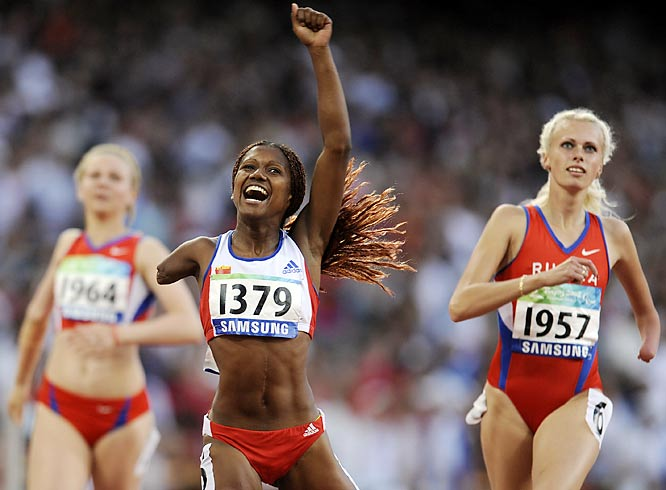Yunidis Castillo of Cuba wins gold in the 100, just ahead of Elena Chistilina (right) and Nikol Rodomakina (left) of Russia.