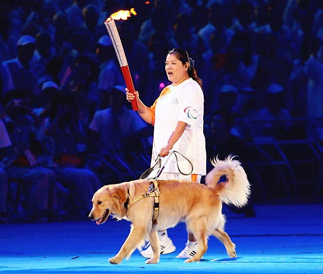 Chinese blind torchbearer Ping Yali enters the stadium during the opening ceremonies.