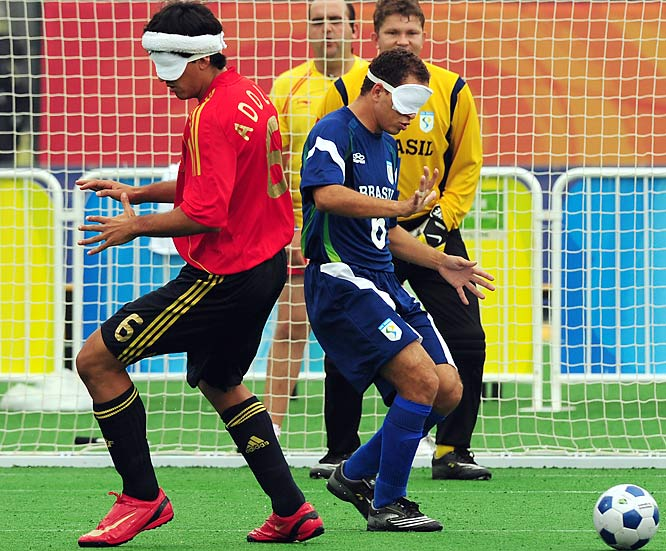 Brazil's Marcos Felipe (right) vies for the ball with Spain's Samuel Adolfo Acosta in front of Brazil goalkeeper Fabio Vasconcelos Ribeiro.