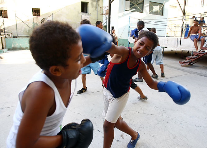 Youngsters exchange jabs at the Rafael Trejo Gymnasium in Old Havana.