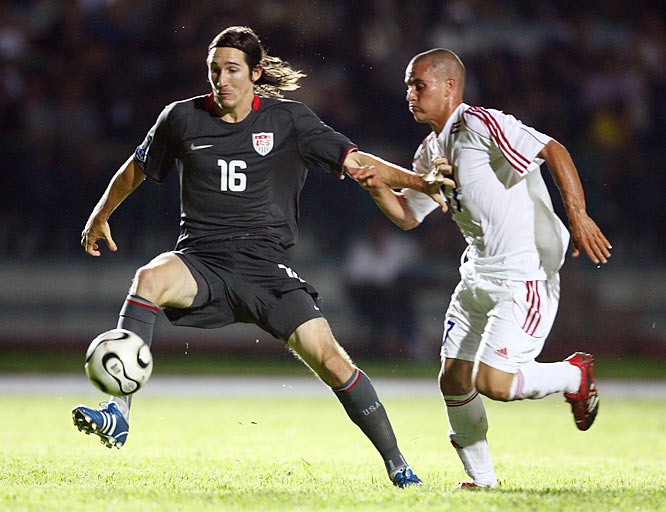 Sacha Kljestan works against Cuba's Pedro Faife.