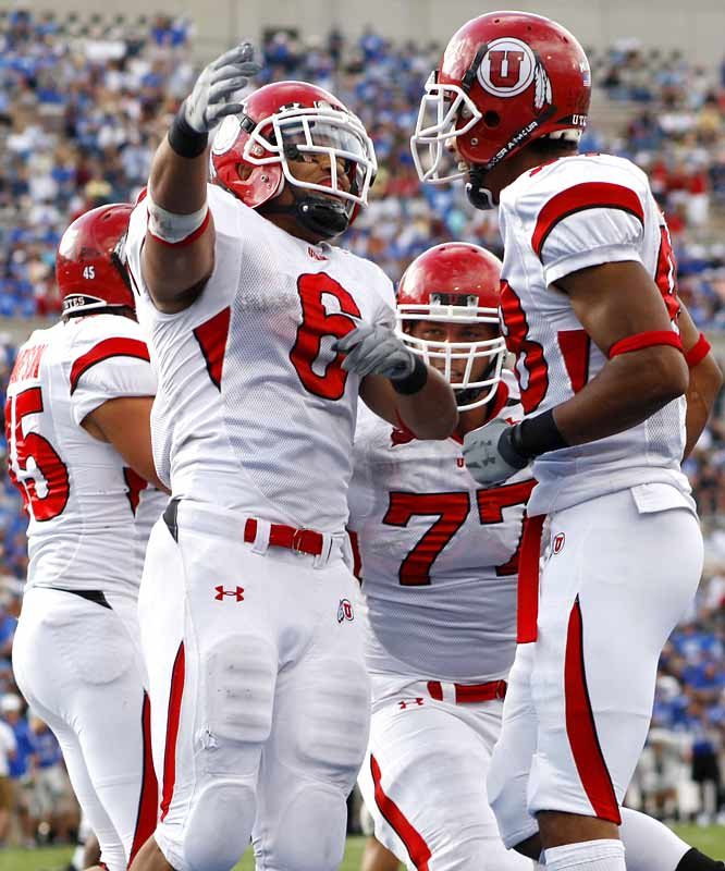 It wasn't always pretty, and it certainly didn't come easy ... but Darrell Mack (left) and the Utes still lay claim to being undefeated and still hold out hopes of playing BYU for a BCS play-in game in November. On the day, Mack rushed for 101 yards and three touchdowns.