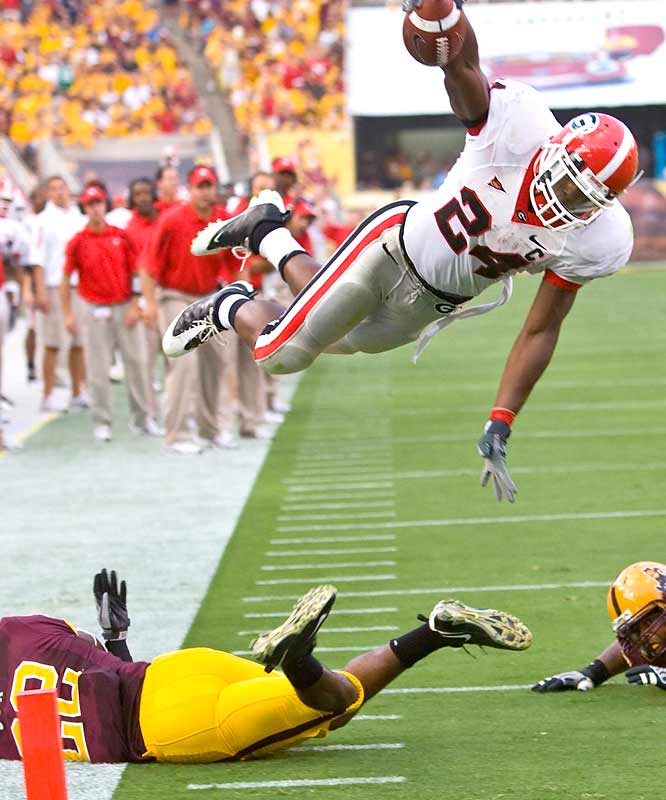 It's a bird, it's a plane ... no, it's Knowshon Moreno (149 rushing yards, 2 TDs) flying through air in the Bulldogs' rare road victory away from the southeast. In fact, this game represented UGA's first voyage to the West Coast since 1960.