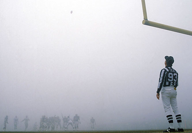 "A thick fog rolled into Chicago's Soldier Field during the second quarter of the Divisional Playoff game between the Bears and Eagles, cutting visibility to about 20 yards for the rest of the game. One fan summed up the situation with a poster that said: ""WHAT THE FOG IS GOING ON?"" The Bears went on to a 20-12 win."