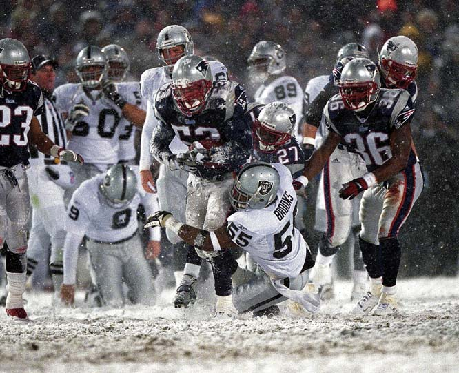 "At a frigid and snow-covered Foxboro Stadium, Tom Brady ushered in the NFL's new ""Tuck rule."" Charles Woodson and the Raiders thought they sealed a win by forcing a Brady fumble, but the ruling was overturned, a new rule was born, and Tom Brady took another step toward his first Super Bowl ring with a 16-13 victory."