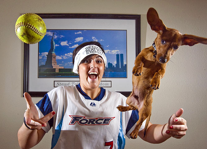 Welcome to former ASU softball pitcher Katie Burkhart's home. Here, Burkhart tosses a softball and her dog, Tomâs, in the air. Burkhart's wearing a Philadelphia Force jersey, as the professional softball team selected her with its No. 1 overall pick in March. Burkhart led Arizona State to the NCAA Championship in June.