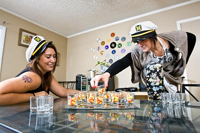 Burkhart plays her roommate, Shelby, in a game of candy corn shot chess.