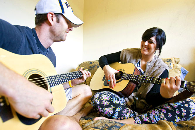 "Burkhart's boyfriend Mark teaches her how to play a few chords on the guitar. Burkhart claims she's ""bad,"" but Mark swears she'll be able to truly rock out as soon as he strings one of his guitars for a lefty."