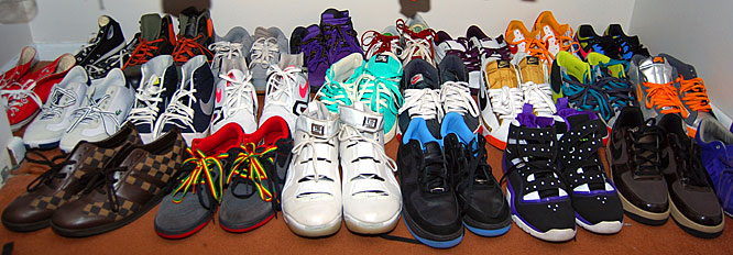 "Johnson's shoe collection sprawls over his closet floor and under his bed. He says he gets a new pair every time something comes up, but his all-time favorites are the brown Louis Vuitton shoes (front left). ""I've never seen anyone else wear 'em,"" Johnson says. When will the shoe fad stop? ""When I'm deceased, I guess."""