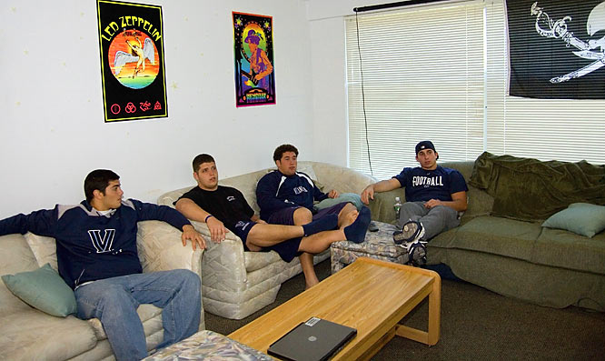 The four Wildcats relax by watching television together.  They are enjoying a departure from their regular practice schedule, as it is the team's bye week.