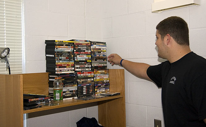 Brannigan picks out a movie to watch from his extensive collection.