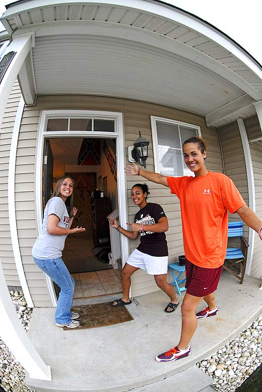 Three members of Virginia Tech's back-to-back ACC championship softball team welcome Campus Cribs into their Blacksburg, Va., town house. From left to right: junior pitcher Heather Lowry, senior third baseman Charisse Mariconda and junior catcher/shortstop Misty Hall.