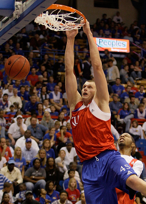 Kansas' Cole Aldrich shows off with a dunk during the annual scrimmage at Late Night at Phog.