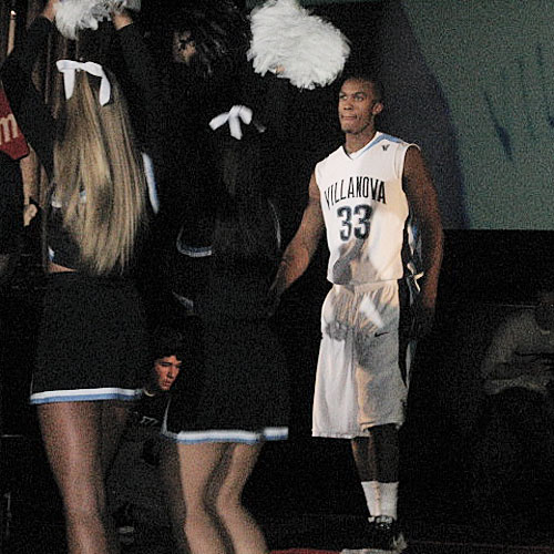 Senior Dante Cunningham walks towards the cheerleaders as he is introduced to the crowd.