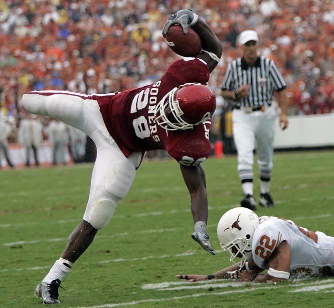 In just his fifth college game, Adrian Peterson ran for 225 yards as the second-ranked Sooners grinded out a 12-0 win over the No. 5 Longhorns. It was the first time Texas was shut out in 24 years -- a string of 281 games.