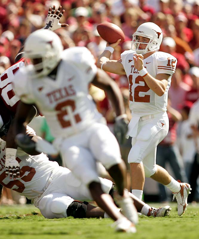 Redshirt freshman Colt McCoy overcame a slow first half by tossing two third-quarter touchdown passes as the Longhorns turned a 10-7 halftime deficit into a 28-10 romp. Texas cornerback Aaron Ross came up with interceptions to end the Sooners' final two drives.