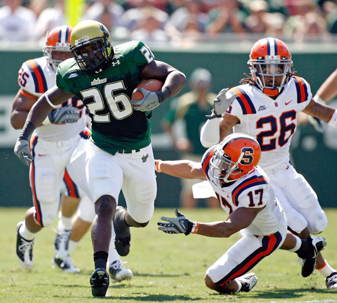 Mike Ford (26) ran for 51 yards as the Bulls improved to 4-0 against the Orange since joining the Big East in 2005.