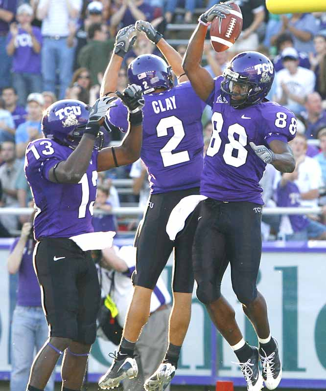The high-flying Horned Frogs amassed 444 yards of offense against the Cowboys on Saturday ... and receiver Jimmy Young (with ball) was responsible for more than half the ouptut -- hauling in five catches for 226 yards and three TDs.