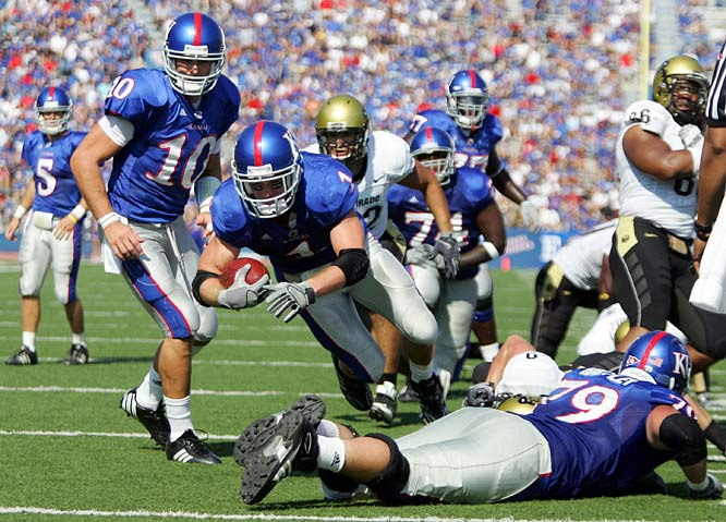On a career-high 31 carries, Kansas tailback Jake Sharp ran for 118 yards and scored three touchdowns in a 30-14 victory over Colorado.