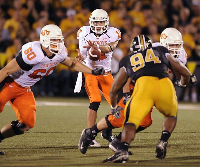 Zac Robinson outplayed Heisman hopeful Chase Daniel, throwing for a pair of scores as Oklahoma State upset Missouri.