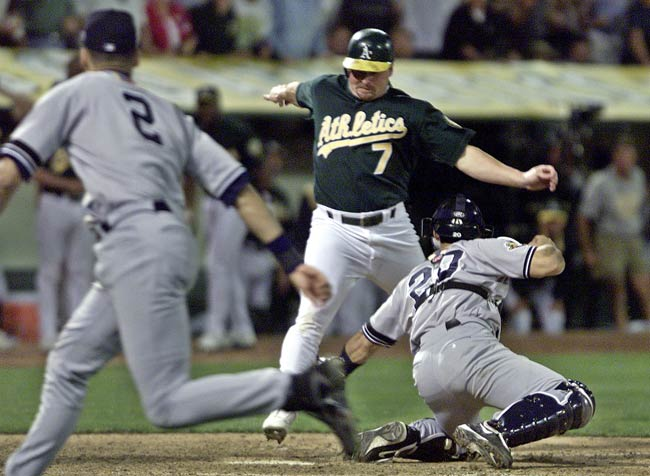 Being down 2-0 in best-of-five series to the A's, Yankee shortstop Derek Jeter backs up an errant relay throw down the first base and flipping it home to cut down Jeremy Giambi, the potential tying run. It will be remembered as one of the best defensive plays in post season history.