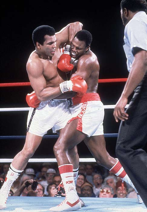 Larry Holmes TKOs Muhammad Ali in 11 rounds to maintain the WBC heavyweight title.