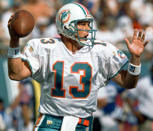 Miami QB Dan Marino breaks Fran Tarkenton's NFL career completions record (3,686).