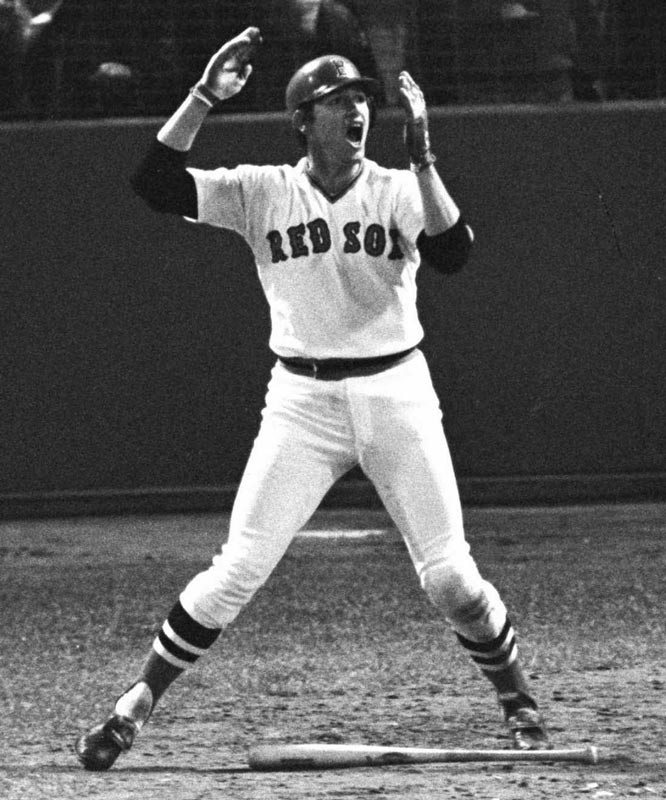 In the bottom of 12th inning of Game Six at Fenway Park, Red Sox backstop Carlton Fisk hits one of the most dramatic home runs in major league history forcing a seventh game with the Reds.