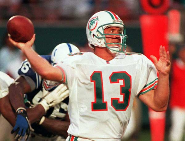 Dan Marino (Miami Dolphins) passes for 521 yards, three touchdowns and completed 35 of 60 against the New York Jets.