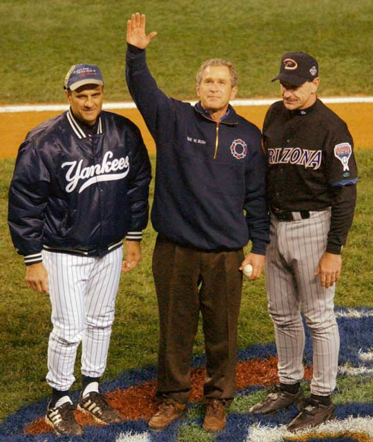 George W. Bush becomes the eighth president to attend a World Series game and the first since Dwight D. Eisenhower to throw out the ceremonial first pitch.