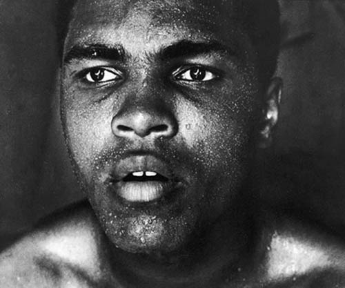 His intensity was on full display in this photo taken in September 1966 as he prepared to defend his title against Germany's Karl Mildenberger. Ali would win on a technical knockout in the 12th round.