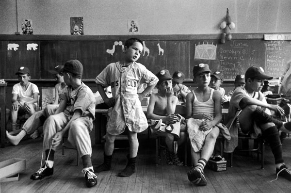 Little Leaguers in Manchester, N.H., dressing in a schoolroom before their first game of the season, waited impatiently for the delivery of all pairs of pants and other sundry uniform items; their formidable leader, Dick Williams, demanded to know what was up as LIFE's Yale Joel snapped away.