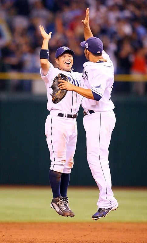 Akinori Iwamura and Carlos Pena celebrated the Rays' Game 2 win. The duo teamed to score the Rays' first run in the game, when Pena drove in Iwamura on a groundout. The normally potent Tampa lineup used small ball to even the series.