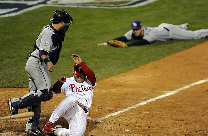 With the bases loaded in the ninth, Evan Longoria did everything he could to get the ball to Dioner Navarro for the force out. As his throw went over the catcher's head, Eric Bruntlett scored the game-winning run, giving the Phillies a 2-1 series lead.